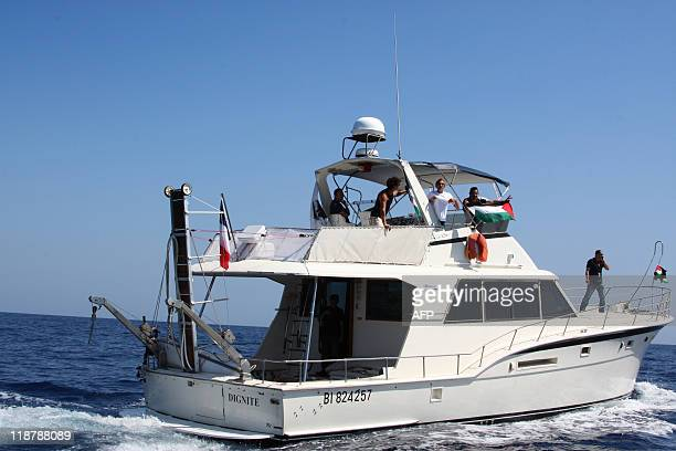 A ship flying the French flag with six people onboard 'Dignité Al Karama' sails off the coast of the French Mediterranean island of Corsica on June...