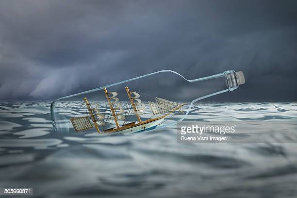 Ship in a bottle in rough waters