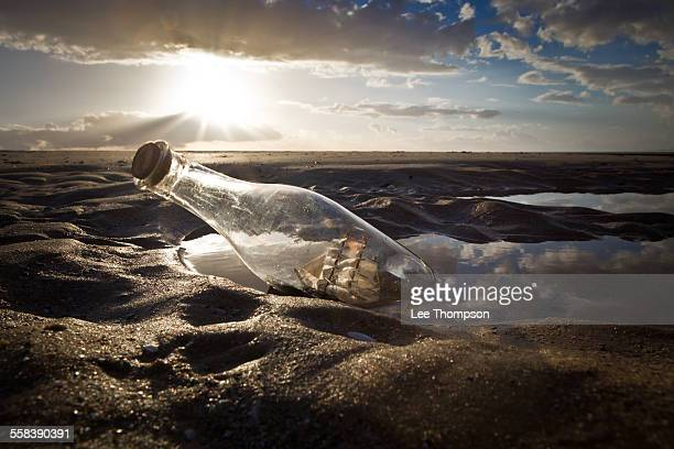 Ship in a Bottle on Beach