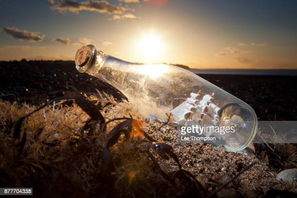 Ship in a Bottle on the Beach at Sunset