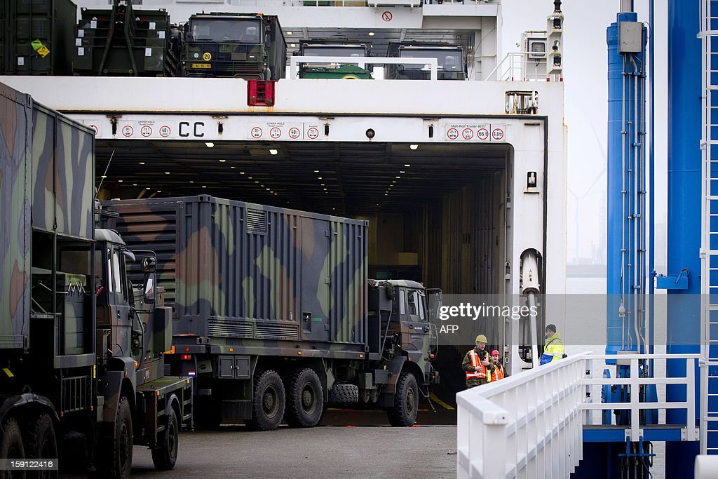 A ship is loaded with Dutch Patriot defence missiles in the Eemshaven (Eems harbor) in Groningen, The Netherlands, on January 8, 2013. The missiles will be shipped to Turkey where they are to be used to protect the country from possible attacks from neighbouring Syria. The Turkish request came after repeated cross-border shelling from Syria, including an October attack that killed five civilians. The Dutch Patriots and support troops will be tasked with defending the city of Adana, population 1.5 million, which lies around 100 kilometres (over 60 miles) from Syria. AFP PHOTO / ANP / EVERT-JAN DANIELS -- The Netherlands out --