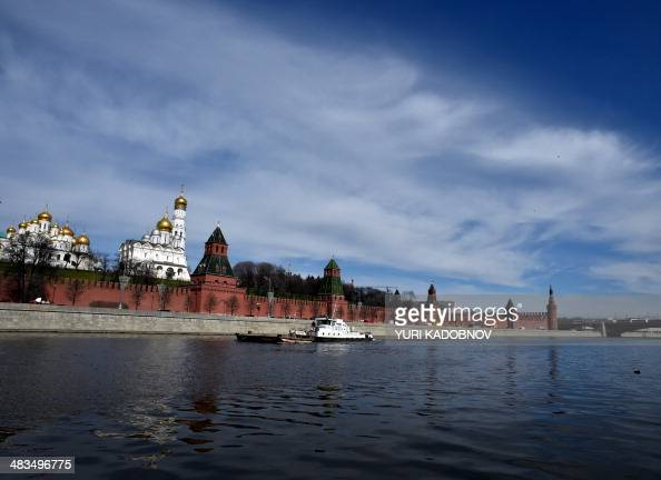 A ship makes its way along the Moskva River in central Moscow on April 9 2014 AFP PHOTO / YURI KADOBNOV