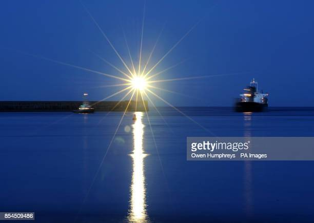 EXPOSURE A ship makes its way into the river Tyne passing the north pier lighthouse at Tynemouth last night