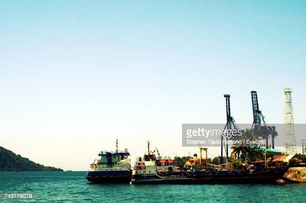 Ship Moored At Harbor Against Clear Sky