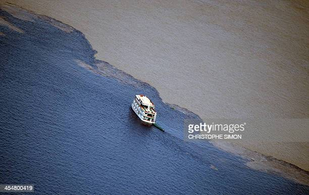 A ship navigates along the Amazon river in Manaus Brazil on December 10 2013 Manaus will host FIFA Word Cup Brazil 2014 football matches AFP PHOTO /...