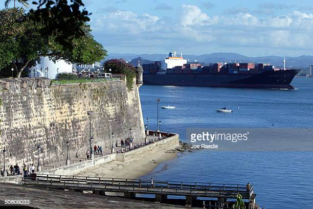 A ship passes past part of the wall that makes up La Fortaleza April 26 2004 in Old San Juan the original capital city of San Juan Puerto Rico...
