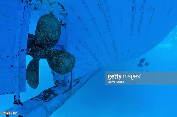Ship propeller and hull, underwater view