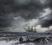 Ship sailing on stormy seas