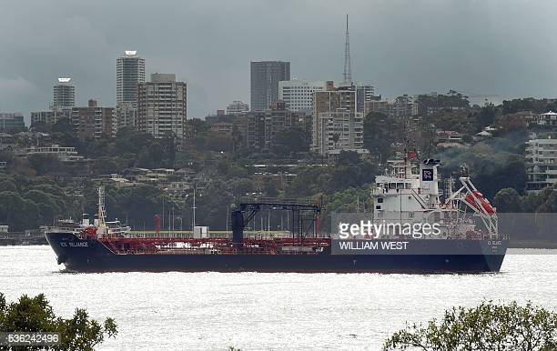 A ship sails on Sydney Harbour in Sydney on June 1 2016 Australia's economy defied market forecasts with strongerthanpredicted expansion in...