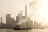 A ship sails up the Huangpu River as heavy smog engulfs the city on December 25 2013 in Shanghai China Heavy smog covered many parts of China on...