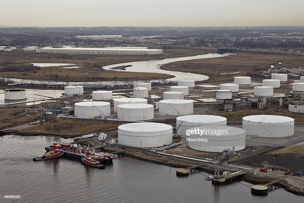 A ship sits berthed at the Citgo Petroleum Corp. terminal as viewed from an A-star 350 B-2 helicopter made by Eurocopter SA, one of six in the fleet of Liberty Helicopters Inc., as it flies over Linden, New Jersey, U.S., on Thursday, March 25, 2010. Liberty Helicopters Inc. is offering to fly weary commuters from New Jersey to Manhattan for about $200 a day, saving them 14 hours in traffic a week and signaling that Wall Street may have seen the worst of the recession. Photographer: Daniel Acker/Bloomberg via Getty Images