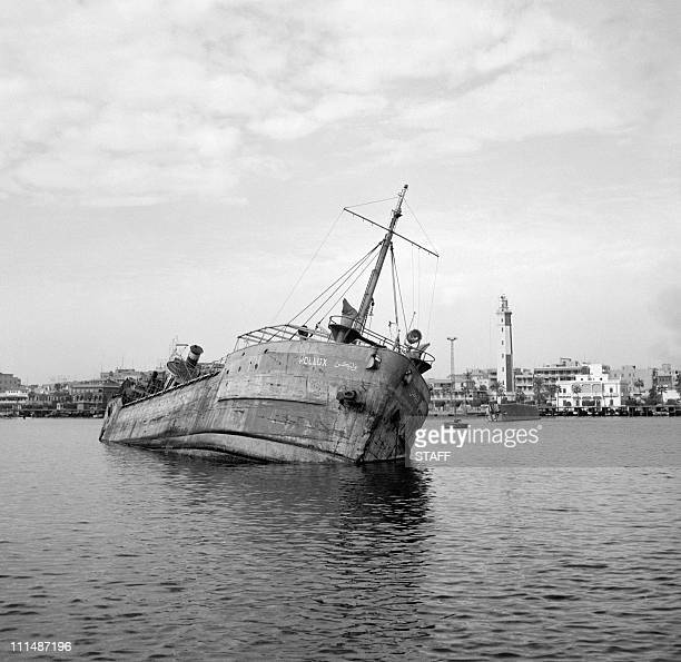 A ship sunk by Egyptians to block the Suez Canal appears at the surface of water11 November 1956 in Port Saïd An AngloFrench intervention has been...