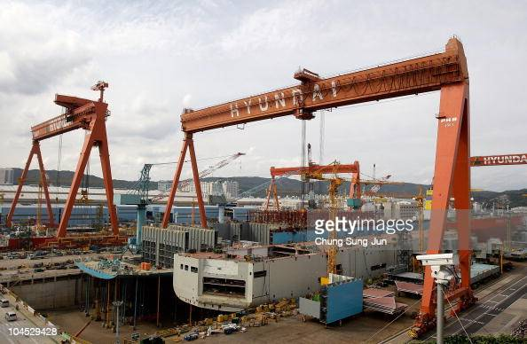 A ship under construction sits at the dock as Hyundai Heavy Industries celebrates 100 million bhp production milestone of 2stroke diesel engines at...