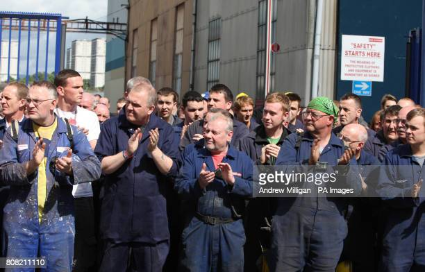 Ship yard workers clap as the coffin of former Glasgow shipyard union leader Jimmy Reid passes workers who lined the streets outside Govan Ship yard...