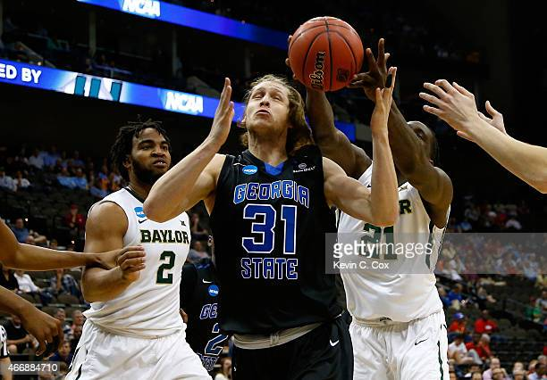 J Shipes of the Georgia State Panthers is fouled by Taurean Prince of the Baylor Bears in the first half during the second round of the 2015 NCAA...