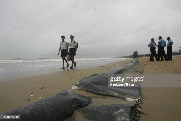 shipping accident ocean seraya oil leak oil slick school children walk past the oil booms which were placed to minimise pollution by coast gaurd on...