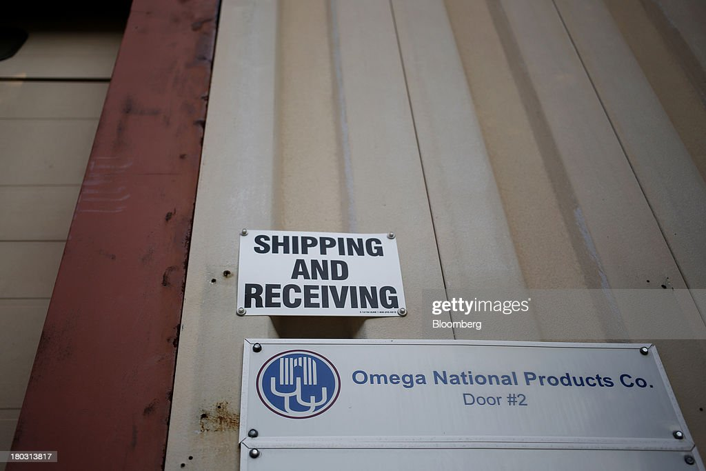 A 'Shipping and Receiving' sign is displayed at the Omega National Products manufacturing facility in Louisville, Kentucky, U.S., on Tuesday, Sept. 10, 2013. The U.S. Federal Reserve is scheduled to release industrial production figures on Sept. 16. Photographer: Luke Sharrett/Bloomberg via Getty Images