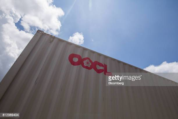A shipping container by Orient Overseas Container Line a unit of Orient Overseas International Ltd stands at the Kwai Tsing Container Terminal in...