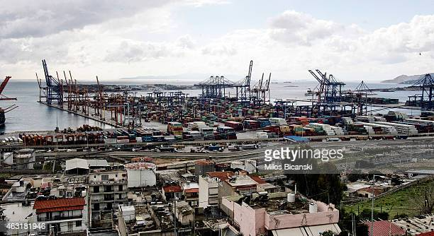 Shipping container cranes line the Pireaus cargo port on February 11 2015 in Pireaus Greece The assent of the new radical Syriza government brought...