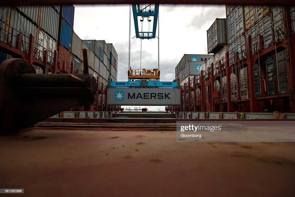 A shipping container is unloaded from the ship Maersk Seoul, operated by AP Moeller-Maersk A/S, at the APM Terminal in the Port of Rotterdam, in Rotterdam, Netherlands, on Thursday, Sept. 19, 2013. The pace of economic contraction in the Netherlands, which is in its third recession in five years, is slowing. Photographer: Jasper Juinen/Bloomberg via Getty Images