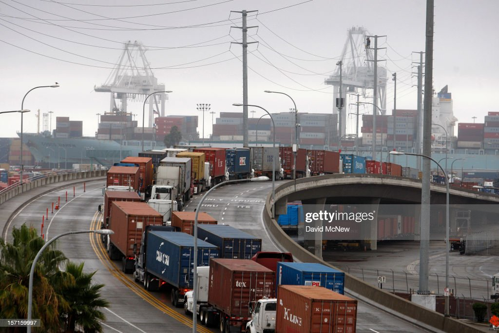 Shipping container trucks sit in traffic as the International Longshore and Warehouse Union strikes, putting a halt to most of the work at the busiest seaport complex in the nation on November 29, 2012 in Long Beach, California. The strike is the largest work stoppage at the ports of Los Angeles and Long Beach since a lockout by shipping companies in 2002 when President George W. Bush intervened with a court injunction to resolve the labor standoff.