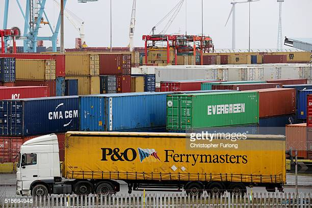 Shipping containers and vehicles wait to be loaded for export at Liverpool Docks on March 8 2016 in Liverpool United Kingdom The United Kingdom a...