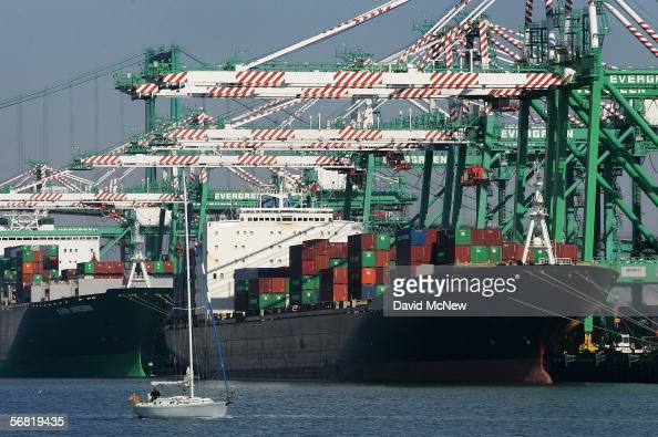 Shipping containers are loaded onto ships in the Port of Los Angeles on February 10 2006 in San Pedro California The US trade gap reached the...