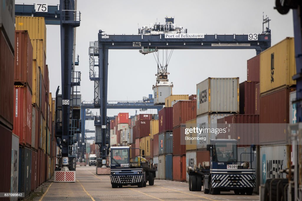 Shipping containers are moved at the Port of Felixstowe Ltd., a subsidiary of CK Hutchison Holdings Ltd. in Felixstowe, U.K., on Tuesday, Aug. 22, 2017. U.K. exporters are still reaping the benefits of a weaker pound, but they're not sure how long the boost will continue as the country gets closer to withdrawing from the European Union. Photographer: Simon Dawson/Bloomberg via Getty Images