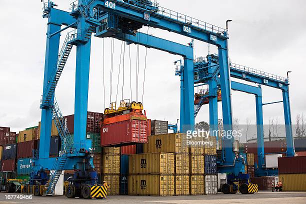 Shipping containers are moved by cranes manufactured by Shanghai Zhenhua Heavy Industry Co Ltd while on the dockside at Mombasa port managed by the...