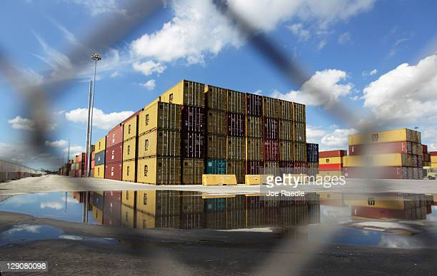 Shipping containers are seen at Port Everglades on the day that the United States Congress is scheduled to vote on free trade deals on October 12...