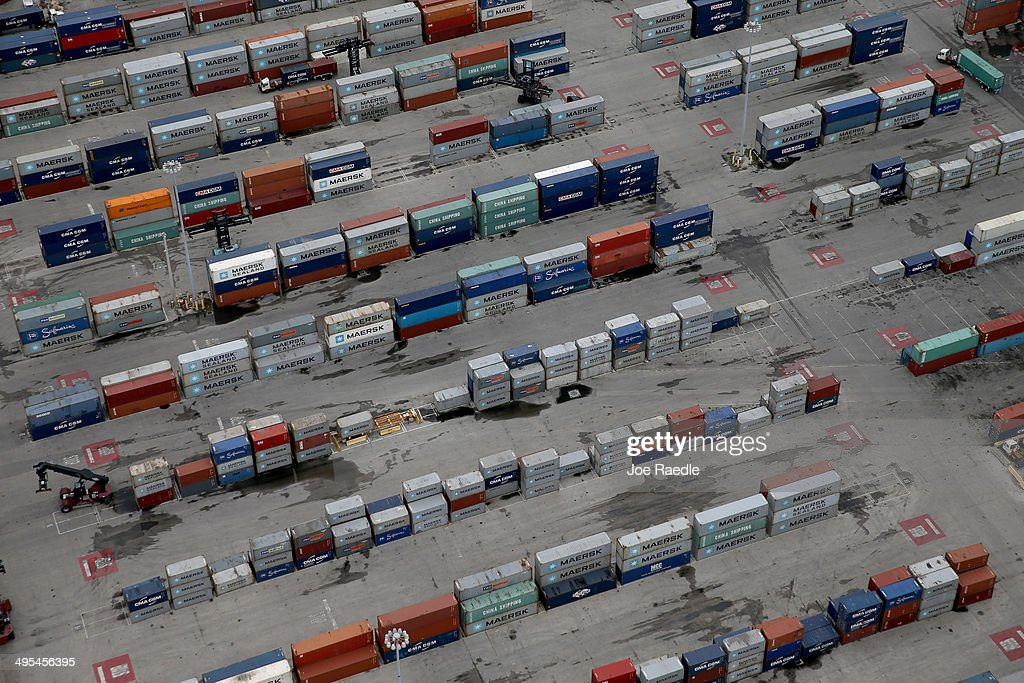 Shipping containers are seen in PortMiami June 3, 2014 in Miami, Florida. According to numerous scientists, south Florida could be flooded by the end of the century as global warming continues to melt the Arctic ice, in turn causing oceans to rise. U.S. President Barack Obama and the Environmental Protection Agency yesterday announced a rule that would reduce the nation's biggest source of pollution, carbon emissions from power plants, 30% by 2030 compared to 2005 levels. It is widely believed that these emissions are a main cause of global warming.