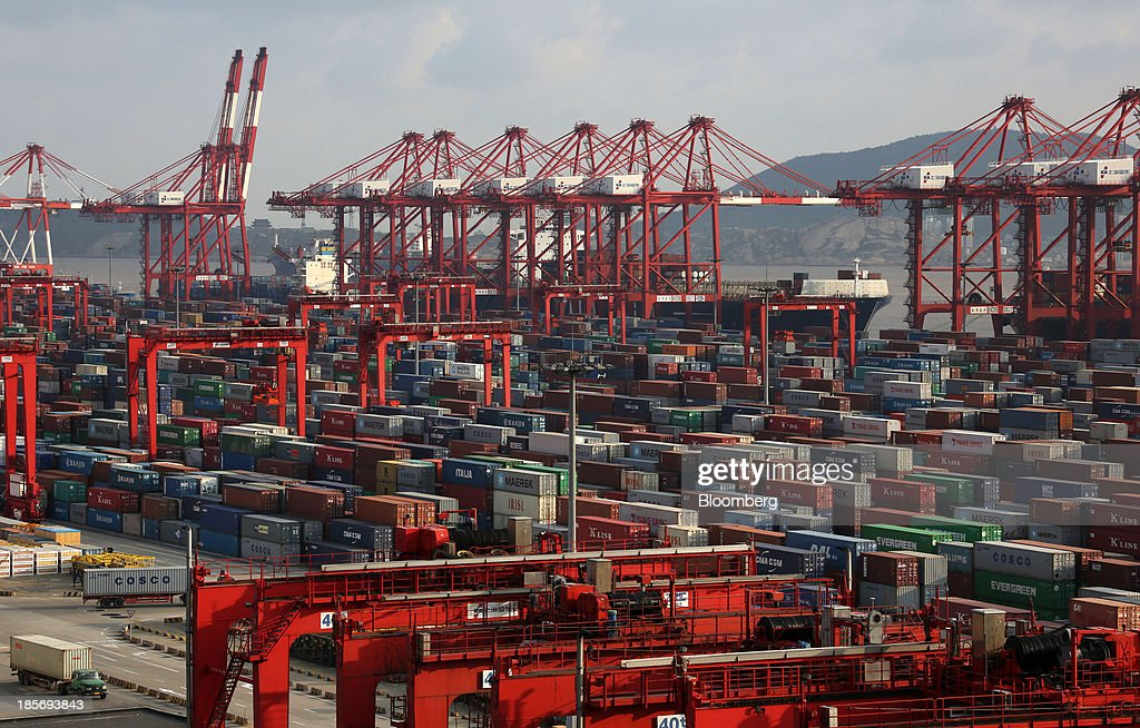 Shipping containers are stacked at the Yangshan Deep Water Port, part of China (Shanghai) Pilot Free Trade Zone's Yangshan free trade port area, in Shanghai, China, on Wednesday, Oct. 23, 2013. The area is a testing ground for free-market policies that Premier Li Keqiang has signaled he may later implement more broadly in the world's second-largest economy. Photographer: Tomohiro Ohsumi/Bloomberg via Getty Images
