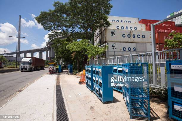 Shipping containers by Cosco Shipping Holdings Co and Hamburg Sud owned by AP MoellerMaersk A/S stand at the Kwai Tsing Container Terminal in Hong...