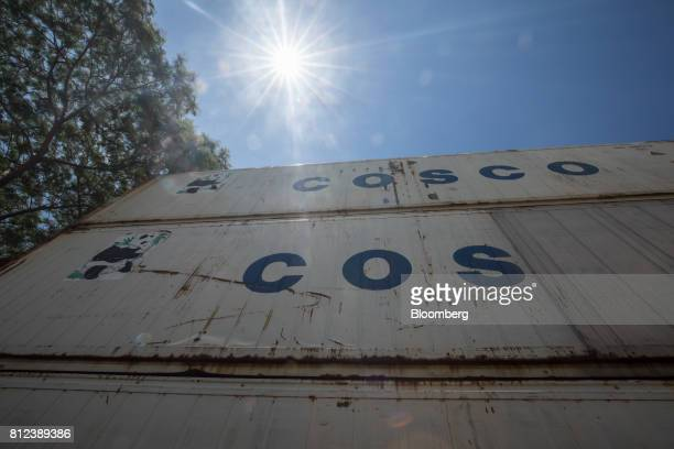 Shipping containers by Cosco Shipping Holdings Co stand at the Kwai Tsing Container Terminal in Hong Kong China on Tuesday July 11 2017 Cosco offered...