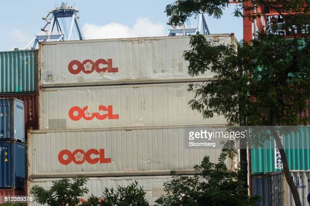 Shipping containers by Orient Overseas Container Line a unit of Orient Overseas International Ltd stand at the Kwai Tsing Container Terminal in Hong...