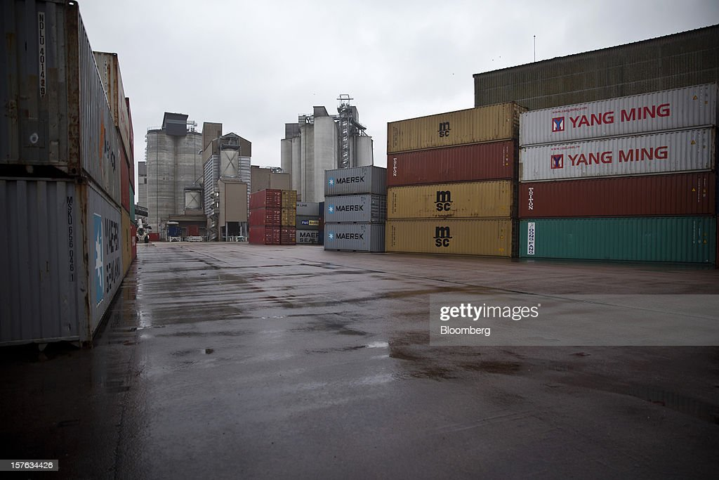 Shipping containers for cereal grain stand on the dockside at the Groupe Soufflet plant in Nogent-sur-Seine, France, on Tuesday, Dec. 4, 2012. European Union corn imports may be the second-highest on record this season after drought parched crops and a surge in wheat exports curbed domestic grain supply. Photographer: Balint Porneczi/Bloomberg via Getty Images