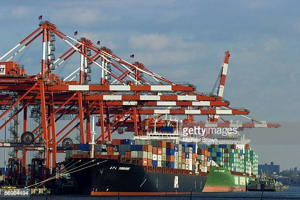 Shipping containers lie stacked on a ship docked at the Port Newark Container Terminal the thirdlargest cargo terminal in New York harbor on February...