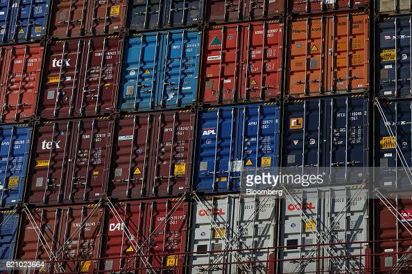 Shipping containers sit aboard the Ludwigshafen Express container vessel operated by HapagLloyd AG at the container terminal operated by DP World Ltd...