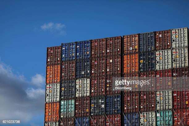 Shipping containers sit aboard the Ludwigshafen Express container vessel operated by HapagLloyd AG on the dockside at the container terminal operated...