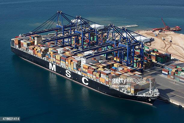 Shipping containers sit aboard the MSC Bari cargo vessel during loading operations at the COSCO Pacific Ltd terminal at Piraeus port operated by...