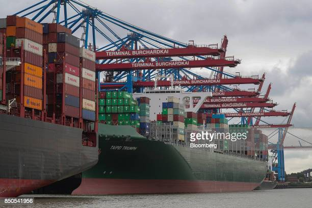 Shipping containers sit on board the Taipei Triump container ship operated by Evergreen Marine Corp at the Port of Hamburg in Hamburg Germany on...