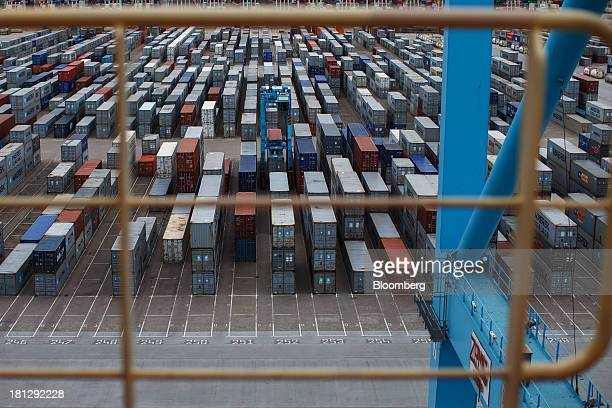 Shipping containers sit on the dockside at the APM Terminal operated by AP MoellerMaersk A/S in the Port of Rotterdam in Rotterdam Netherlands on...