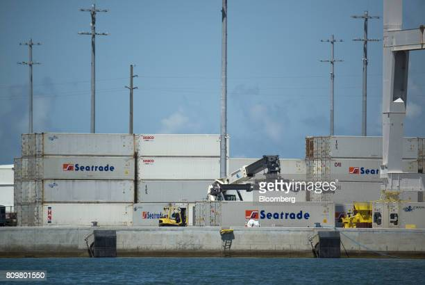Shipping containers sit stacked at Port Canaveral in Cape Canaveral Florida US on Wednesday July 5 2017 The US Census Bureau released trade balance...