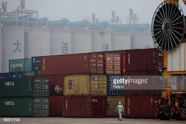 Shipping containers sit stacked at Port of Dalian on September 10 2013 in Dalian of Liaoning Province China China's exports rose 72 percent year on...