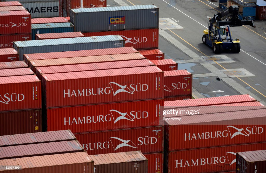 Shipping containers sit stacked at the Port of Veracruz in Veracruz, Mexico, on Thursday, Sept. 26 2013. Mexico reported a preliminary trade deficit of $234.2 Million for August, according to the national statistics agency, known as Inegi. Photographer: Susana Gonzalez/Bloomberg via Getty Images