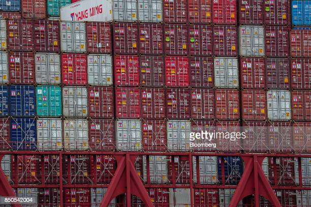 Shipping containers sit stacked on board the Al Dahna container ship operated by the United Arab Shipping Co at the Port of Hamburg in Hamburg...
