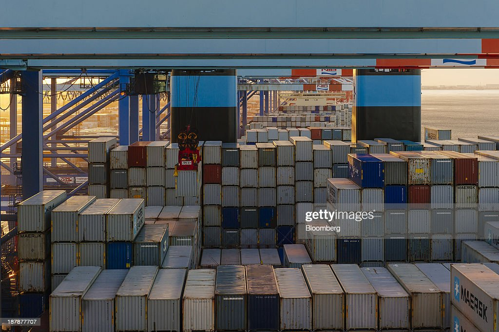 Shipping containers stand aboard the Maersk Mc-Kinney Moeller Triple-E Class container ship, operated by A.P. Moeller-Maersk A/S, during loading operations in the Port of Bremerhaven in Bremerhaven, Germany, on Monday, Nov. 11, 2013. A.P. Moeller-Maersk A/S's container-shipping line, the world's largest, reported an 11 percent increase in third-quarter profit after cost cuts countered a decline in freight rates. Photographer: Kristian Helgesen/Bloomberg via Getty Images