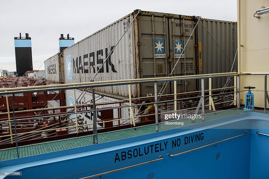 Shipping containers stand beyond a swimming pool for crew members aboard the Majestic Maersk Triple E class ship, one of the world's largest vessels, operated by A.P. Moeller-Maersk A/S at Langelinie pier in Copenhagen, Denmark, on Tuesday, Sept. 24, 2013. A.P. Moeller-Maersk A/S says it won't cut its investment in developing markets from Asia to South America even as creditors turn their backs. Photographer: Freya Ingrid Morales/Bloomberg via Getty Images