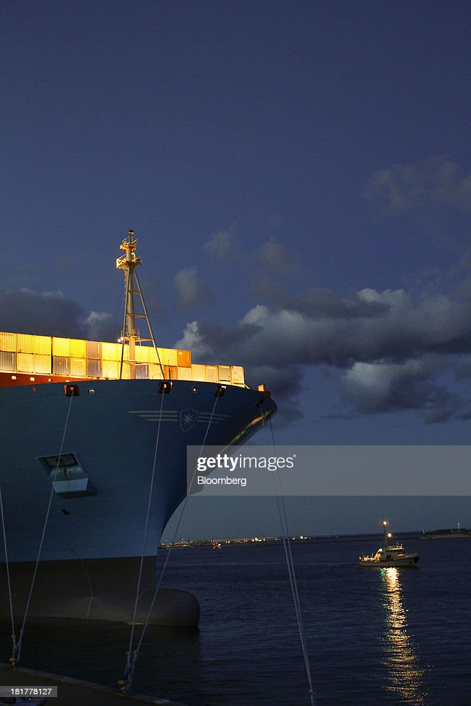 Shipping containers stand illuminated at night on the prow of the Majestic Maersk Triple E class ship, one of the world's largest vessels, operated by A.P. Moeller-Maersk A/S at Langelinie pier in Copenhagen, Denmark, on Tuesday, Sept. 24, 2013. A.P. Moeller-Maersk A/S says it won't cut its investment in developing markets from Asia to South America even as creditors turn their backs. Photographer: Freya Ingrid Morales/Bloomberg via Getty Images