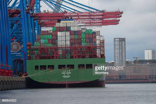 Shipping containers stand on board the CSCL Mars container ship operared by China Shipping Container Lines Co at the Port of Hamburg in Hamburg...